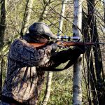 man holding hunting rifle