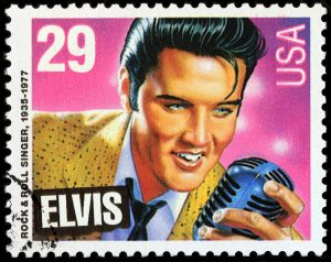 LUGA RUSSIA - NOVEMBER 6 2016: A stamp printed by UNITED STATES shows image portrait of famous American singer Elvis Presley circa 1993
