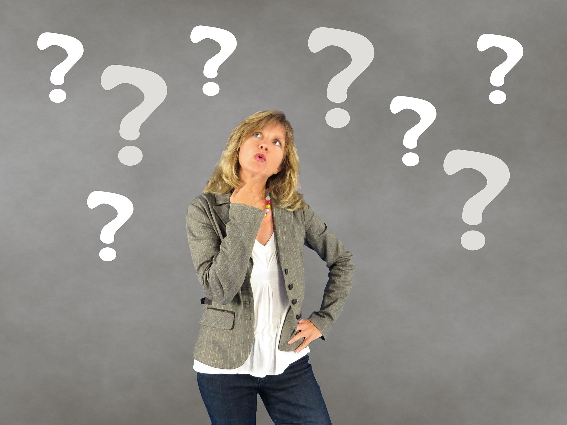 woman with floating question marks